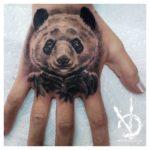 Delvius realism tattoo style