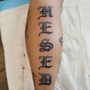 """""""hesed"""" script tattoo"""