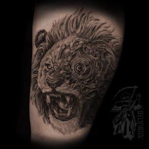 blackwork mechanized lion tattoo