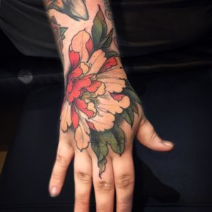 Neotraditional flower tattoo